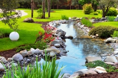 Spring flowers in the Asian  Japanese garden with a pond