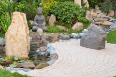 Small japanese garden with Buddha statue