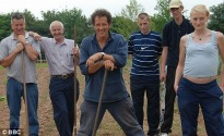 picture of Monty Don and gardening team