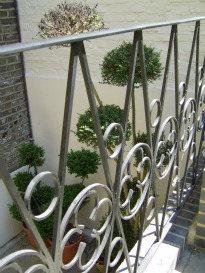 picture of planting behind railings