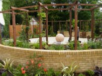 picture of raised beds and pergola