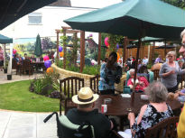 picture of residents and guests enjoying the garden