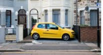 picture of car parked in front garden