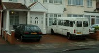 picture of car and van parked on front drive of house