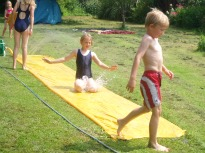 picture of children playing on a water slide