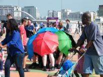 image of miniature 'tube train' of umbrellas