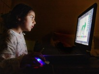picture of boy playing computer game