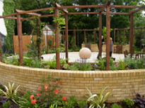 image of raised beds and central water feature