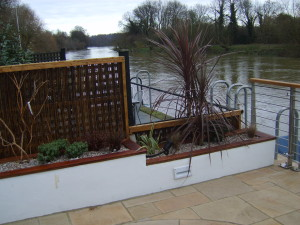 Contemporary Waterside - a-view-of-the-planting-and-river