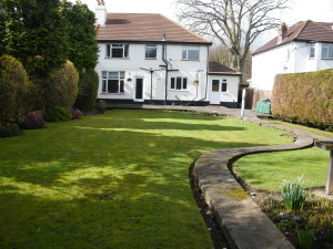Traditional but Modern Garden - looking-up-to-the-house