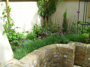 A Tiny Courtyard Transformed - new-beds