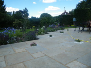 Country Garden with Natural Water Course - new-patio-with-planting