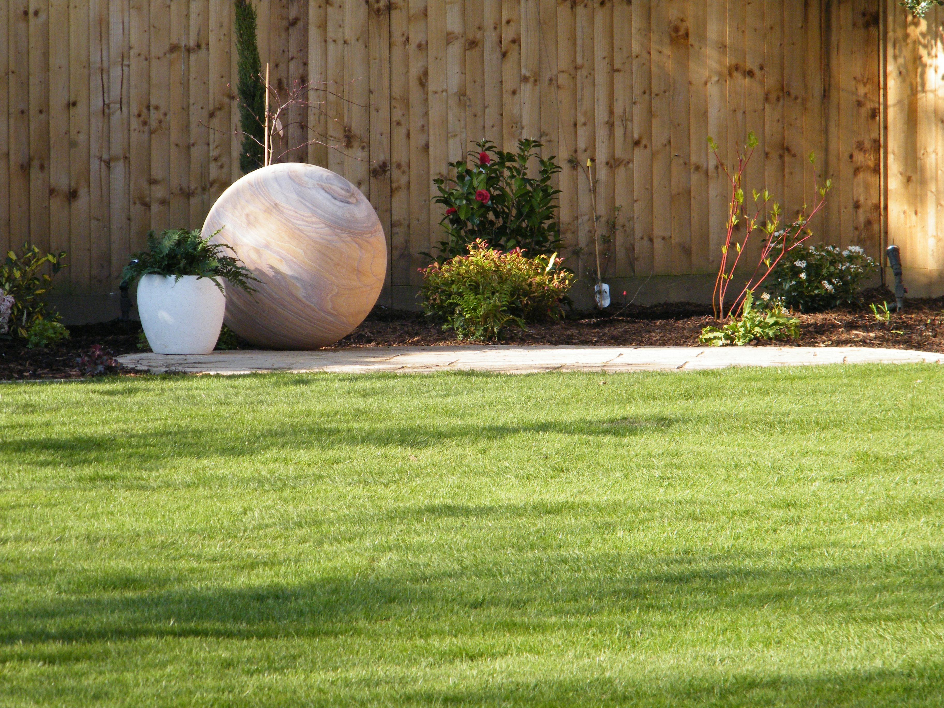 love a triangle rock feature and lawn - Garden Design Triangular Plot