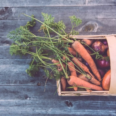 Urban Farming - carrots in a basket on the table